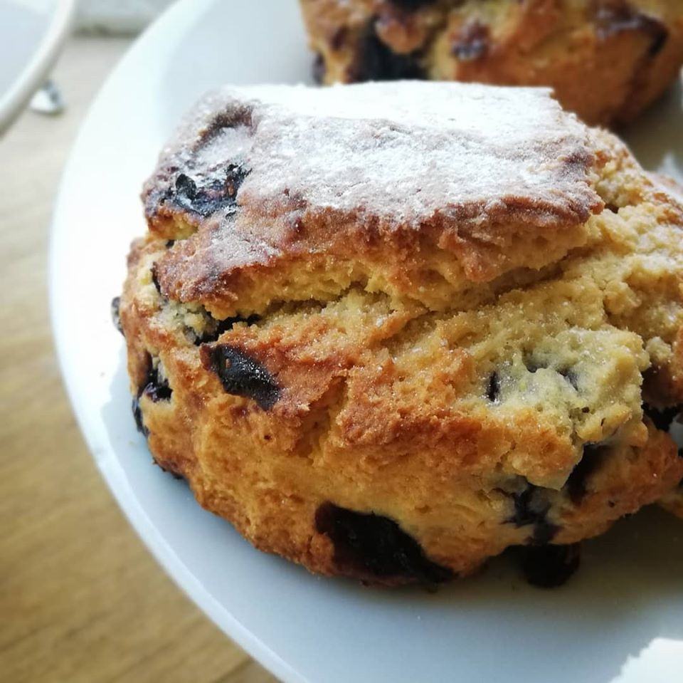 Warm blueberry scone served with butter Cafe Paradiso